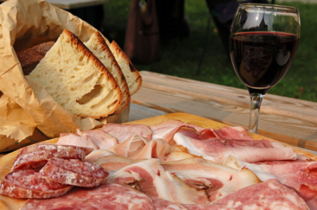 Charcuterie Board with meats, french bread and wine