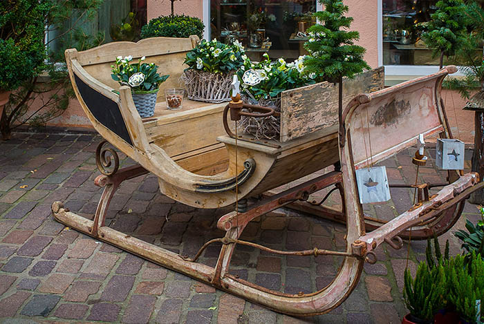 wooden sleigh with winter porch pots
